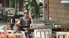 Gustavia Cafe Girl on Cellphone - stock footage