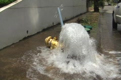 Car Breaks Street Water Fire Hydrant and Stop Sign + audio Stock Footage