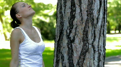 Young woman hugs a tree Stock Footage
