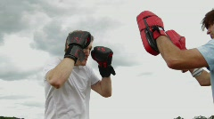 Two male boxing in park - stock footage