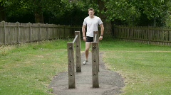 Male fitness training on parallel dip bar Stock Footage