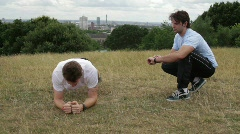 Male fitness exercise in park with personal trainer - stock footage