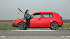Woman w Car Trouble Stock Footage