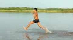 boy jumping in lake - summer vacations - stock footage