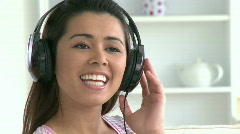 Beautiful asian woman listen to music - stock footage