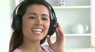 Stock Video Footage of Beautiful asian woman listen to music