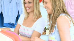 Young cute women trying pullover Stock Footage