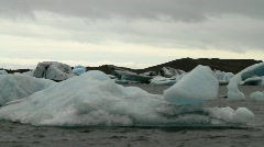 Glacial icebergs and black clouds upon the Lagoon - HD 1920 X 1080 - stock footage