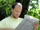 Man reading newspaper in the park Stock Footage