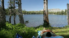 man and dog napping by the lakes edge - stock footage