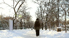 Man taking a walk alone on snowy street - HD 1920 X 1080 Stock Footage