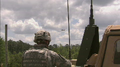 Apache fly over troops Stock Footage