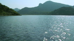 Driving boat on the Lake Skadar in Montenegro Stock Footage
