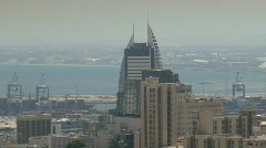 Haifa Sail Tower zoom out into bay Stock Footage