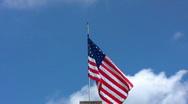 Cross and US flag tilt down 02 Stock Footage