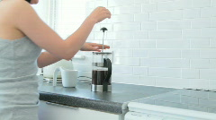 Person pouring coffee from french press into cup Stock Footage