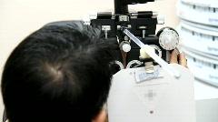 Eye Exam with Eye Doctor - stock footage