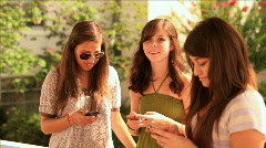 teen girls texting outdoors - stock footage