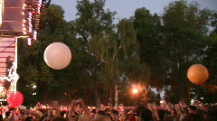 Beach Balls Bounce Over the Crowd at a Concert Stock Footage