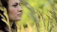 Beautiful sad woman in grassfields Stock Footage