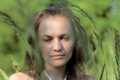 Beautiful sad woman in grassfields Stock Footage