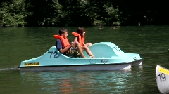 River Beach Peddle Boat Stock Footage