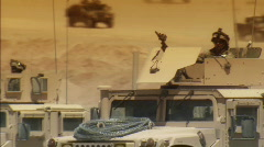 Military caravan in desert 3 Stock Footage