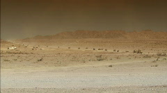 Military caravan in desert Stock Footage