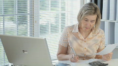 Mature Woman Writing A Check Stock Footage