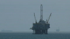 Oil Platform With Cargo Ship And Another Oil Platform In Background Stock Footage
