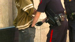 crime and justice, police search handcuffed suspect, #1 - stock footage