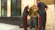 Crime and justice, police search suspect Stock Footage
