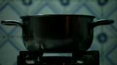 Pot On Gas Stove - stock footage