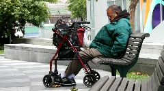 Handicap man on park bench - stock footage