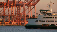 Ferry passing cranes Stock Footage