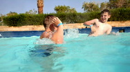 Boys in pool Stock Footage