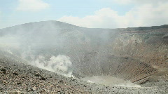 Volcano crater with smoke, Vulcano island, Italy Stock Footage
