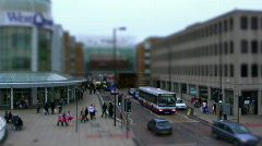 Tilt shift of shopping center: people, traffic  and street HD Stock Footage