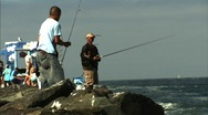 FISHING OFF JETTY Stock Footage