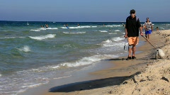 Disabled person on the beach Stock Footage