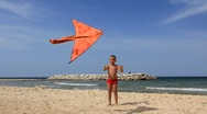 Boy with orange kite (editorial footage) Stock Footage