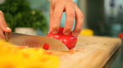 The cook cuts pepper - stock footage