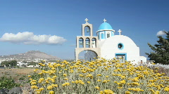 Flowers in Front of Church on Greek Island of Santorini, Greece Stock Footage