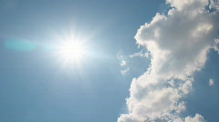 White clouds disappear in the hot sun on blue sky - stock footage