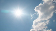 White clouds disappear in the hot sun on blue sky Stock Footage