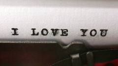 Typing I LOVE YOU on an old manual typewriter Stock Footage