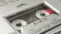Putting an audio music cassette tape into a recorder - stock footage