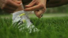 Running Woman ties shoe Stock Footage