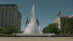 Water Fountain Shoots up in front of LDS Temple Stock Footage
