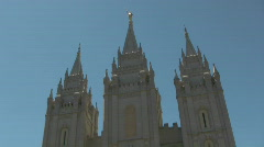 LDS Temple towers over reflection pond Stock Footage